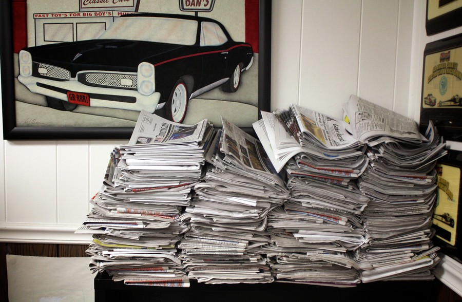 One month's worth of printing on display in Gouwens's office.