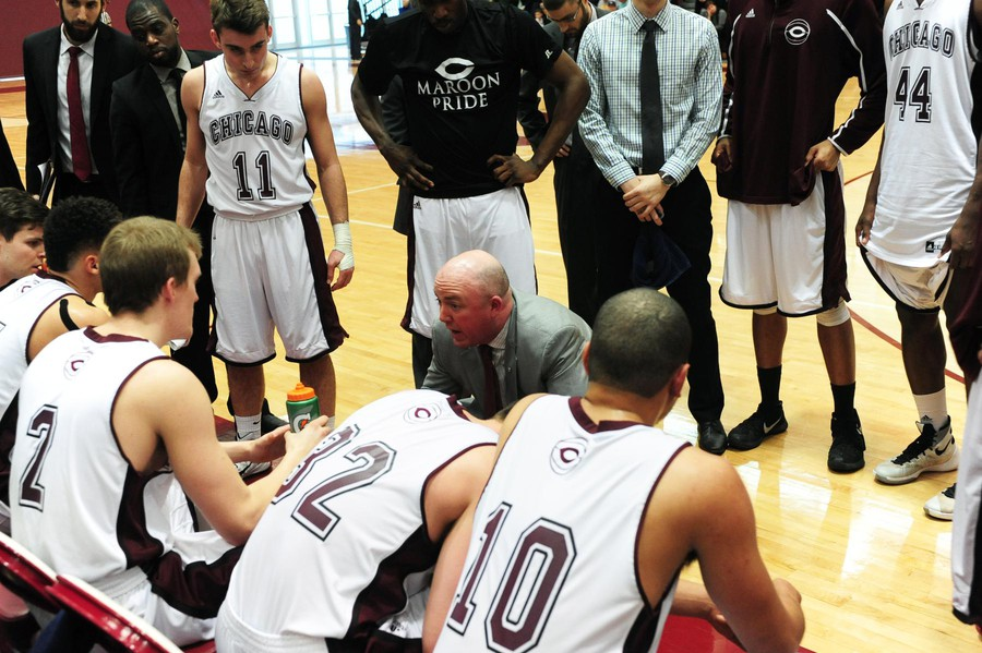 The Maroon men get a pep talk during a timeout.