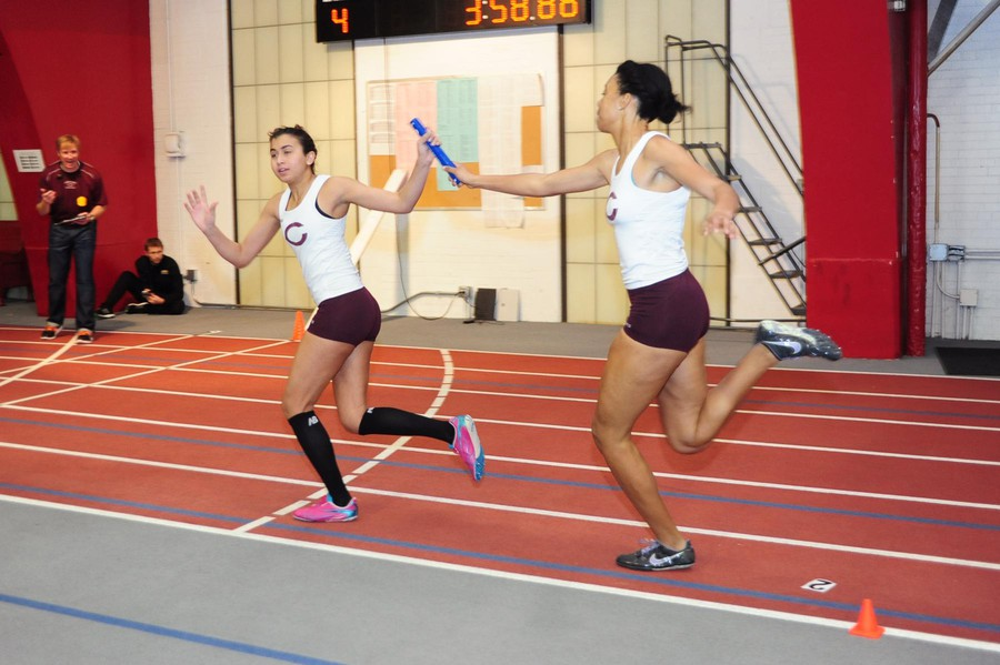 Second-year Alexandra Thompson hands the baton to second-year Nadeen Issa.