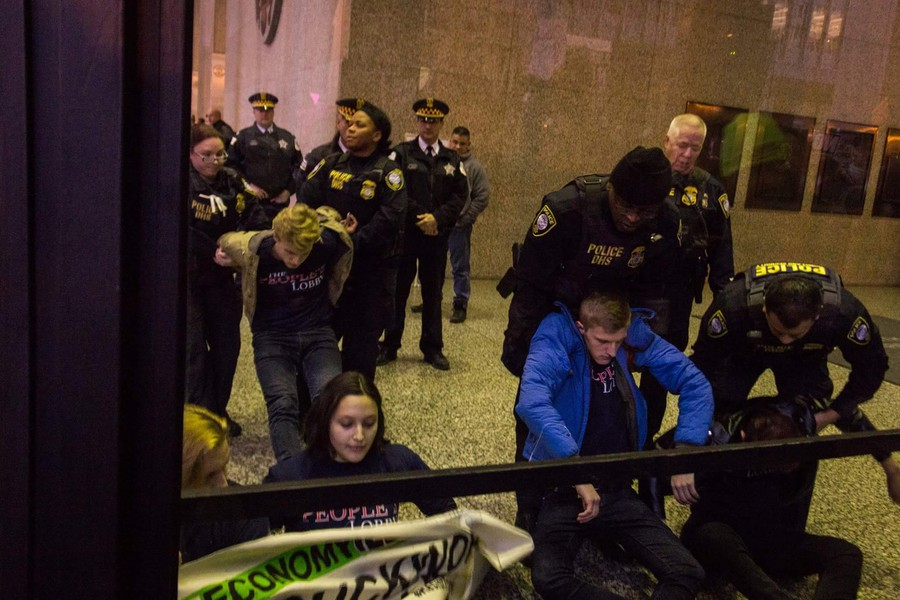 Student Government president Eric Holmberg (right) was arrested yesterday.