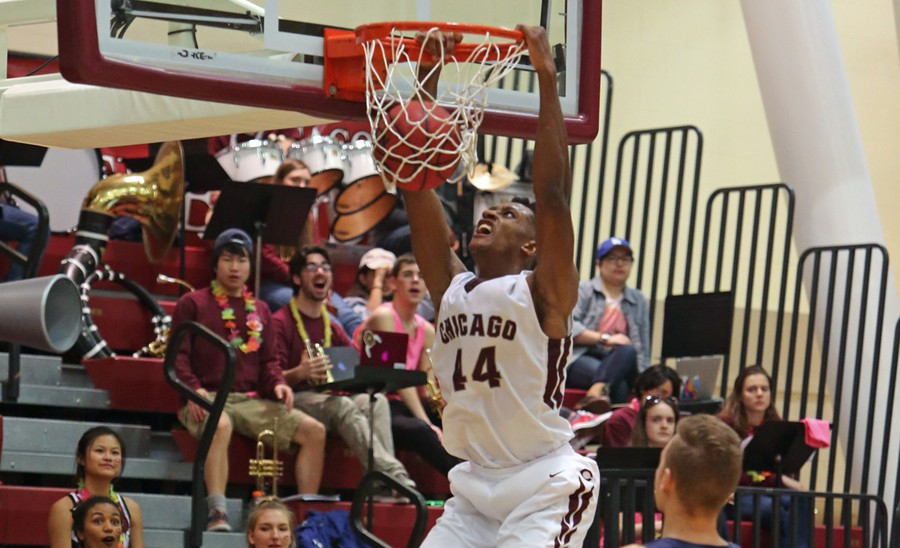 Fourth-year Blaine Crawford dunks with excitement and enthusiasm.