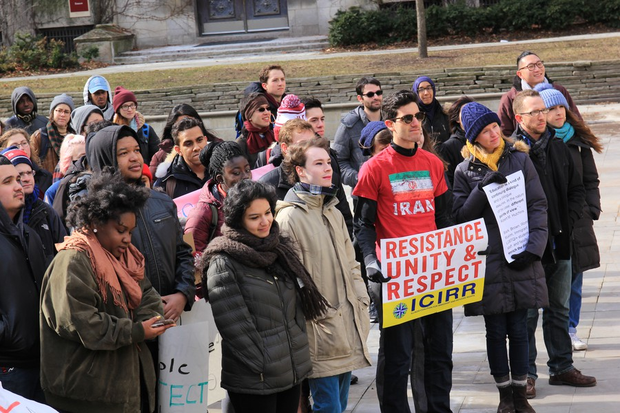 Members of the University community protest President Trump's executive order.