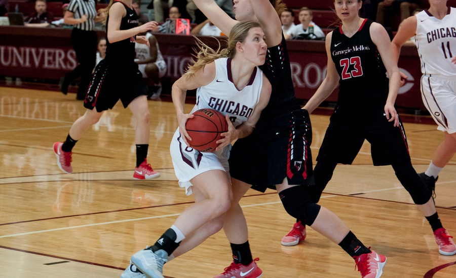 Fourth-year Britta Nordstrom charges towards the basket amidst defenders.