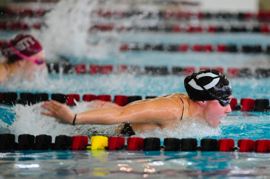 A female swimmer glides through the water.