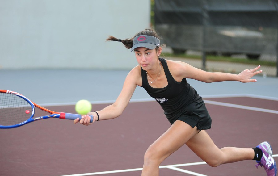 Second-year Kat Stevanovich chases after the ball with intense focus.