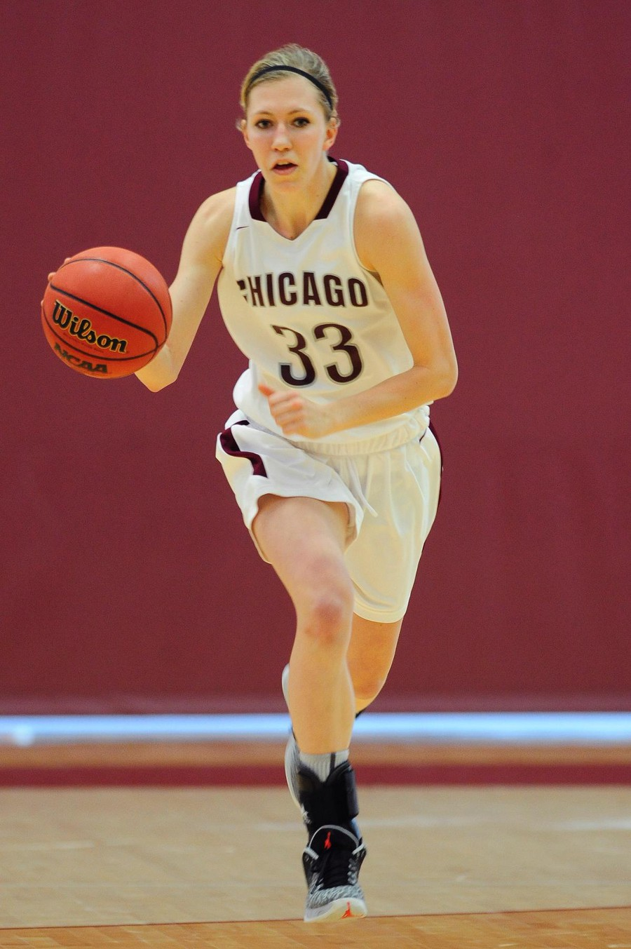 Fourth-year Britta Nordstrom races down the court with her eyes on the basket.