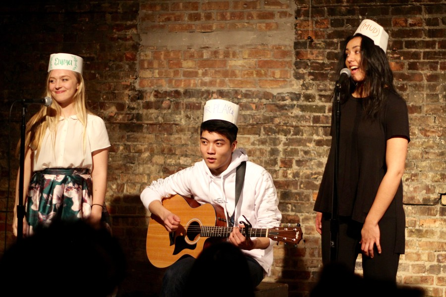 Third-year Emma Preston, second-year Tommy Zhang, and fourth-year Natalie Richardson sing about mud.