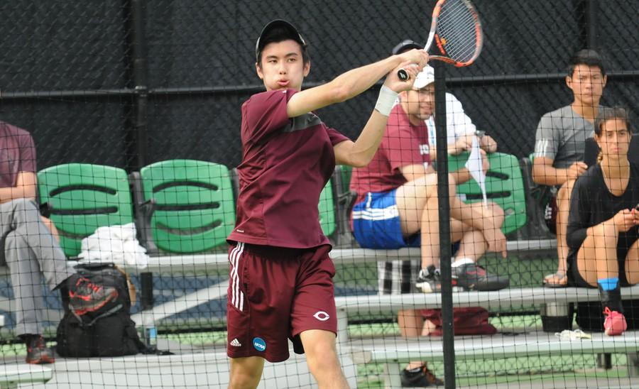 Third-year Nicholas Chua returns a shot.
