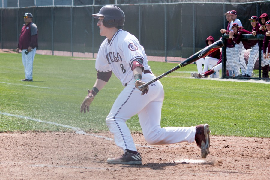 First-year Payton Jancsy begins to run the bases after crushing a pitch on April 8.