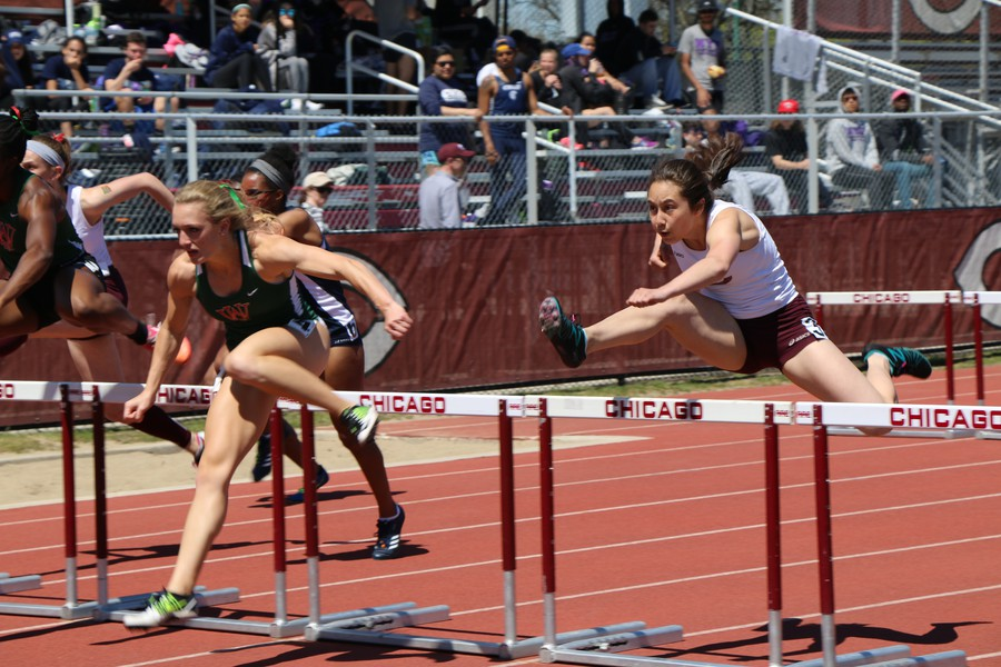 First-year Robin Peter races in the 100-meter hurdles.