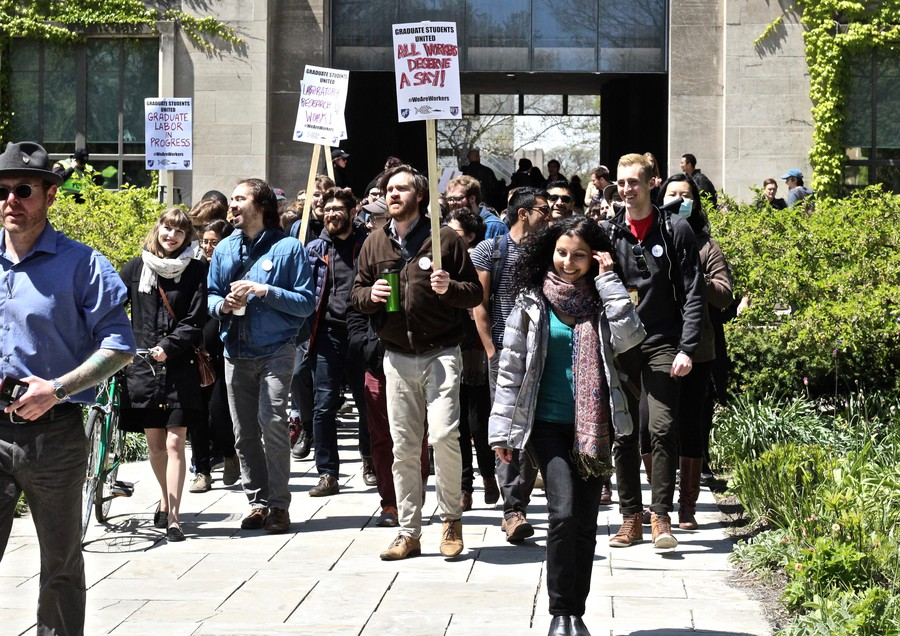 Graduate Students United members rally on the Quad in May 2017.