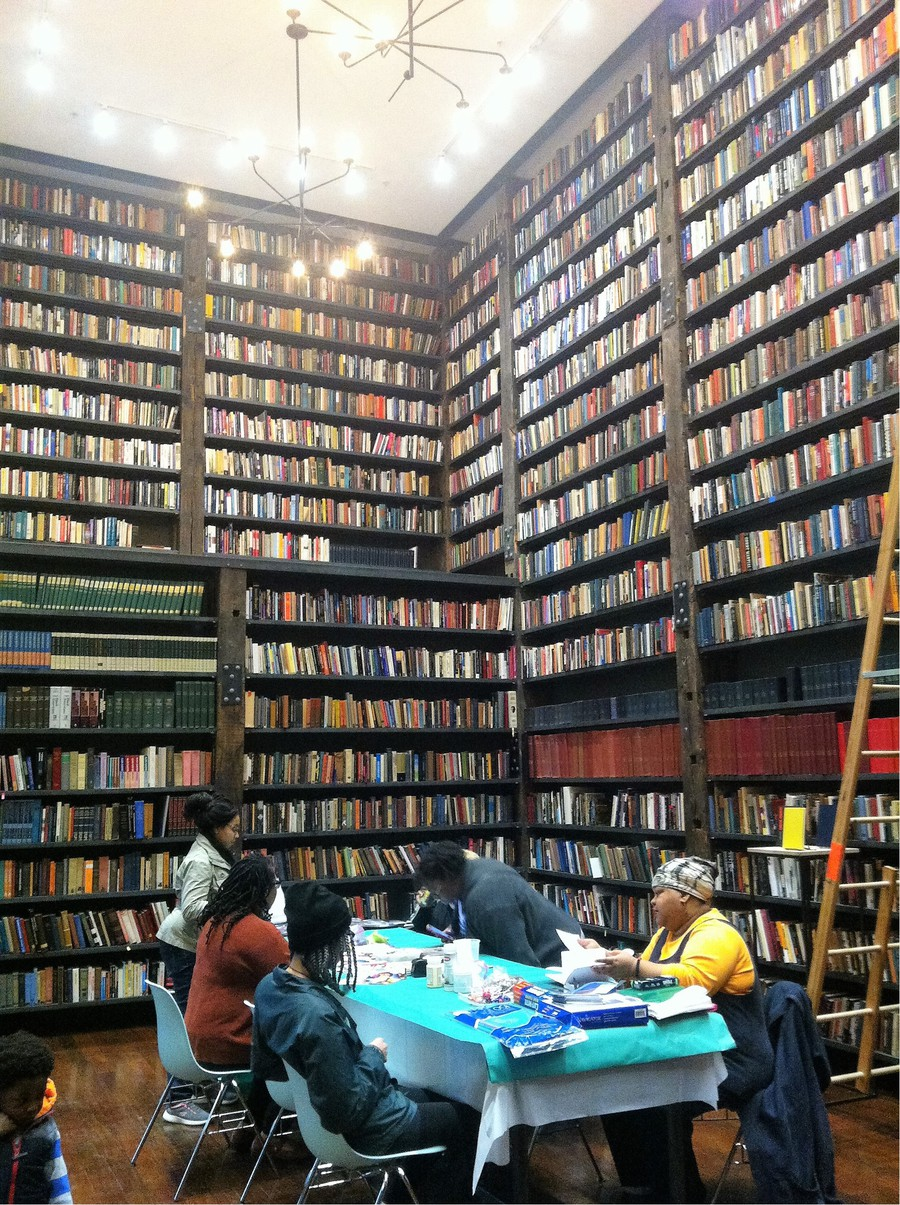Guests visit the Free Black Women's Pop-up Library	at Stony Island Arts Bank.