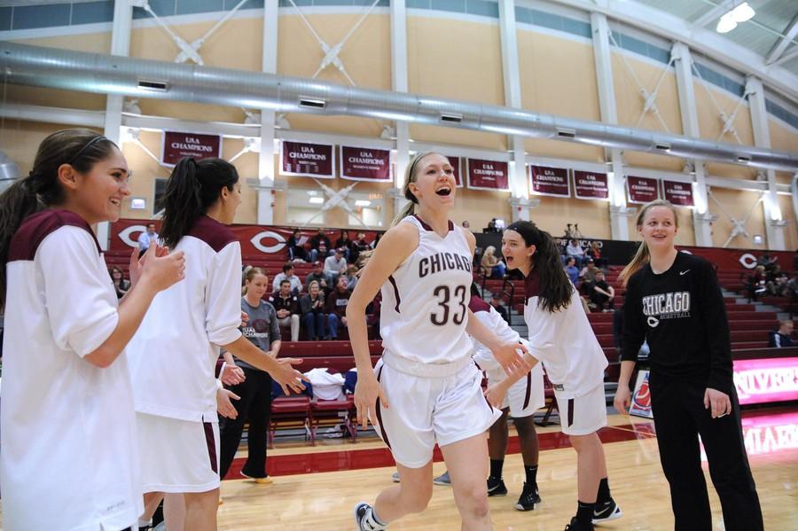Fourth-year Britta Nordstrom runs onto the basketball court.