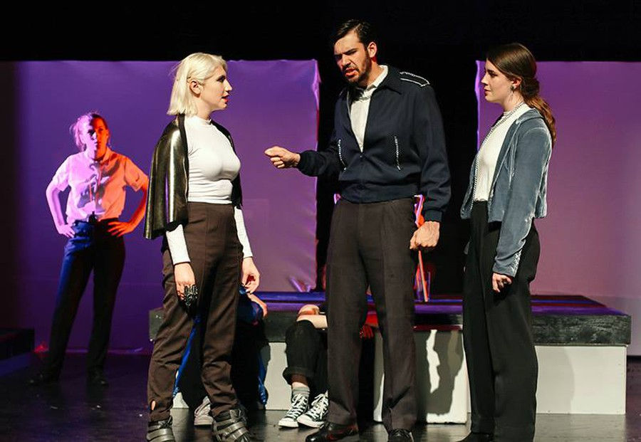 Lear (first-year Thomas Noriega, center) confronts his daughters Regan (third-year Peyton Walker, left) and Goneril (fourth-year Michaela Voit, right).