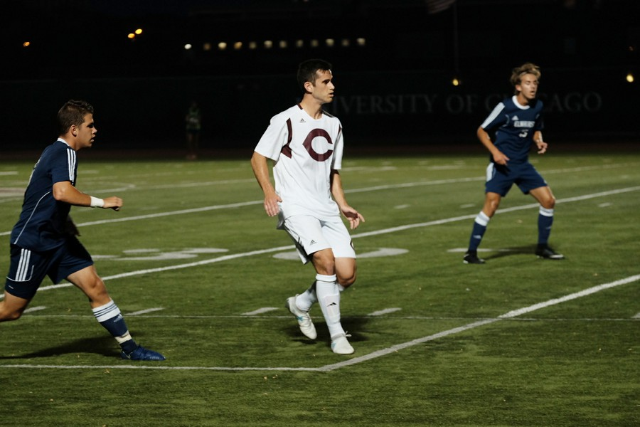Fourth-year Andre Abedian races up the field shadowed by defenders.