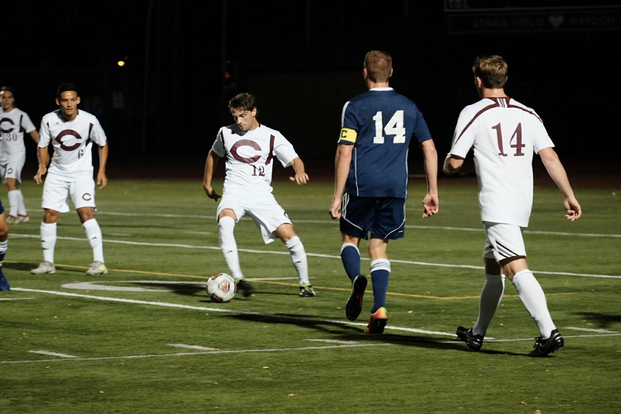 Third-year Josh Scofield dribbles the ball past a defender.