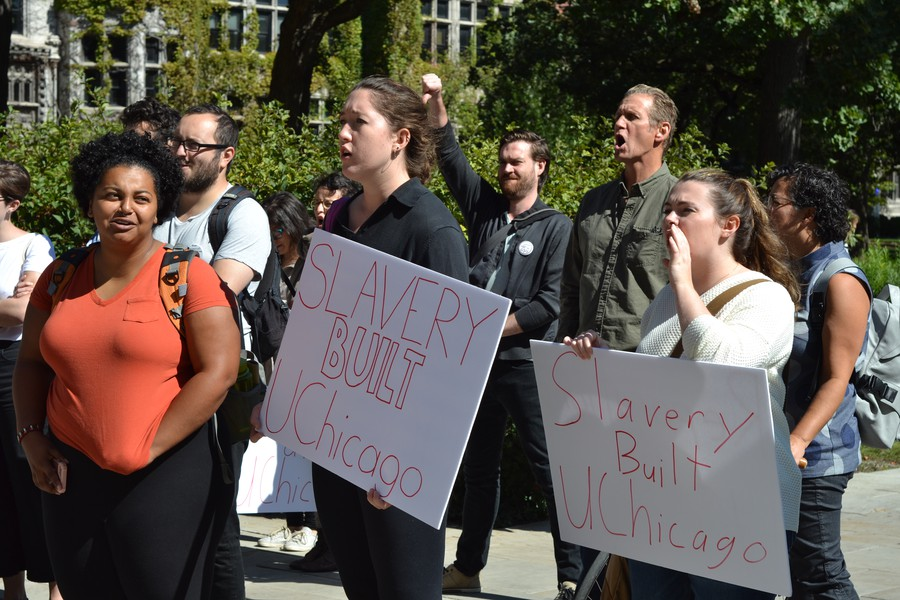Students hold up protest signs at a racial justice rally last Friday.