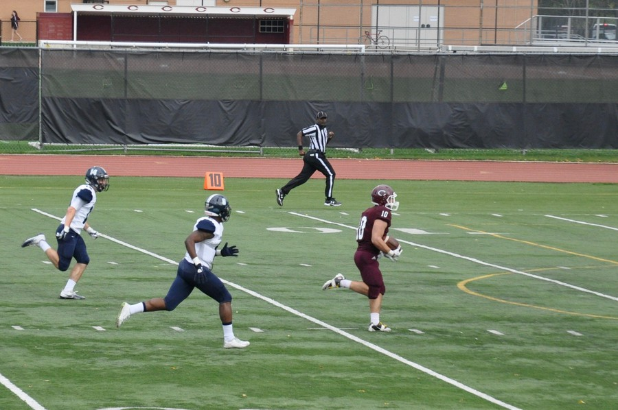 Fourth-year Chandler Carroll rushes home for his first touchdown of the day.