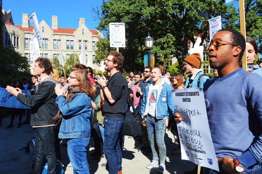 Graduate students rally for unionization in front of Levi Hall on the Monday before the vote.