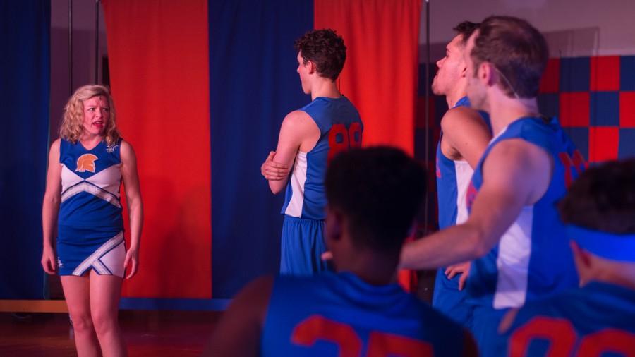 Lysistrata Jones (Mary-Margaret Roberts) addresses a group of basketball players.