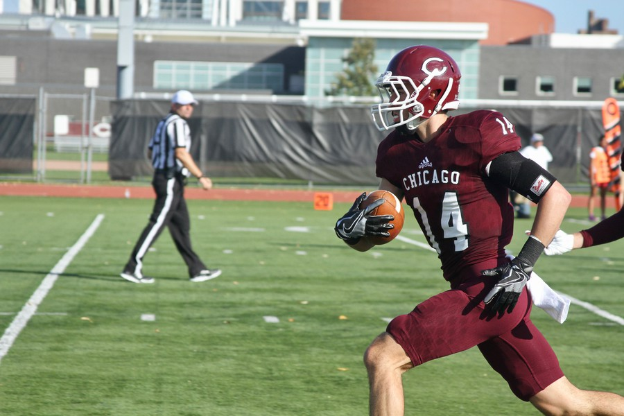 Fourth-year cornerback Andrew Beytagh recovers the ball for the Maroon defense.