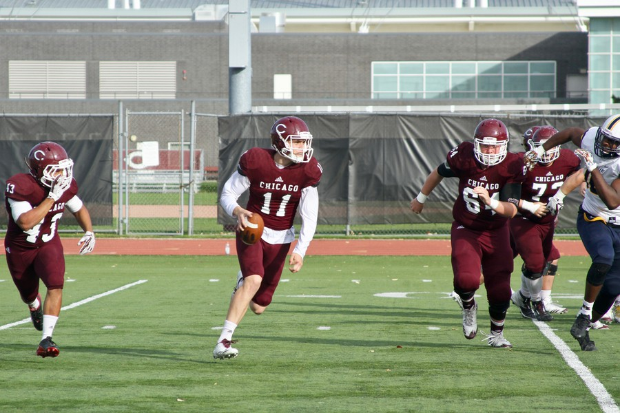 Second-year quarterback Marco Cobian rolls out of the pocket.