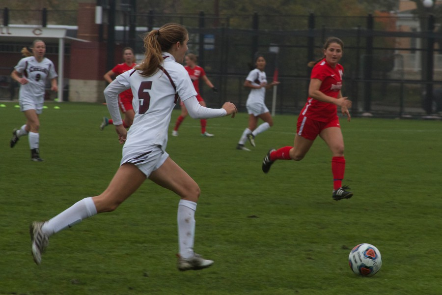 Second-year Clare Suter dribbles through the opposing defense.