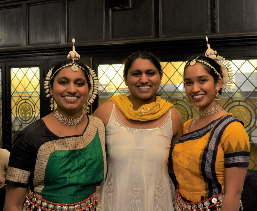 Dancers from the classical Indian dance group Apsara pose in McCormick Lounge.