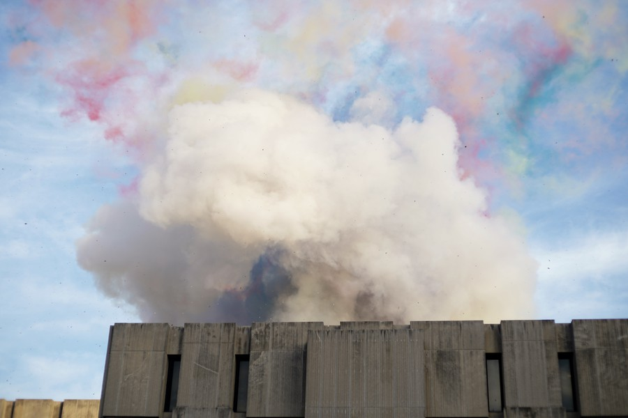 As patches of color slowly dissipate, a light gray mushroom cloud rises from the roof of Regenstein Library.