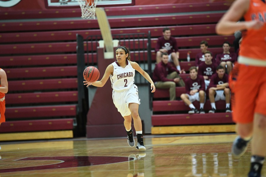 Second-year Mia Farrell brings the ball up the court.