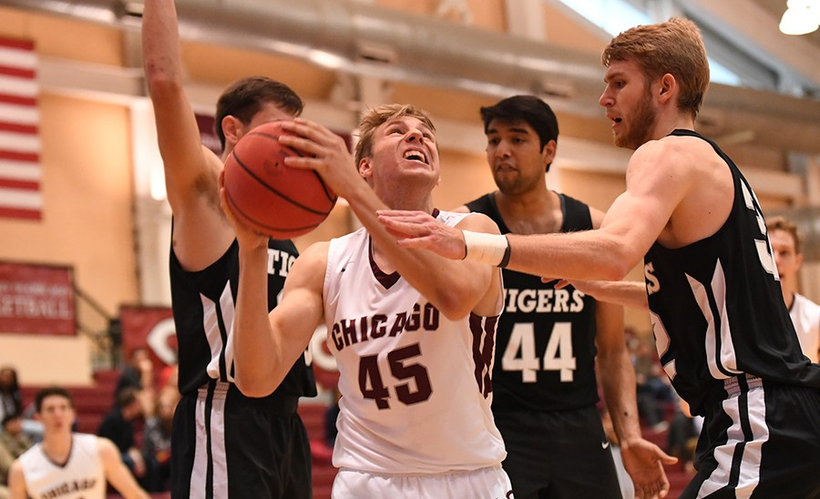 First-year Ryan Jacobsen fights through defenders as he makes his way to the basket.