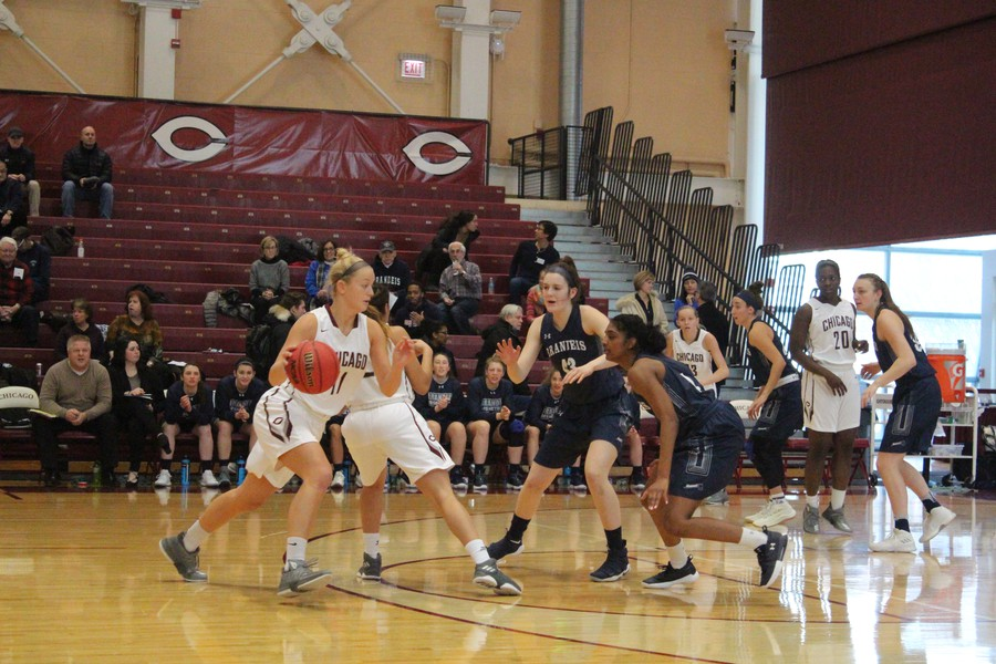Second-year Taylor Lake weaves around her Brandeis opponents.