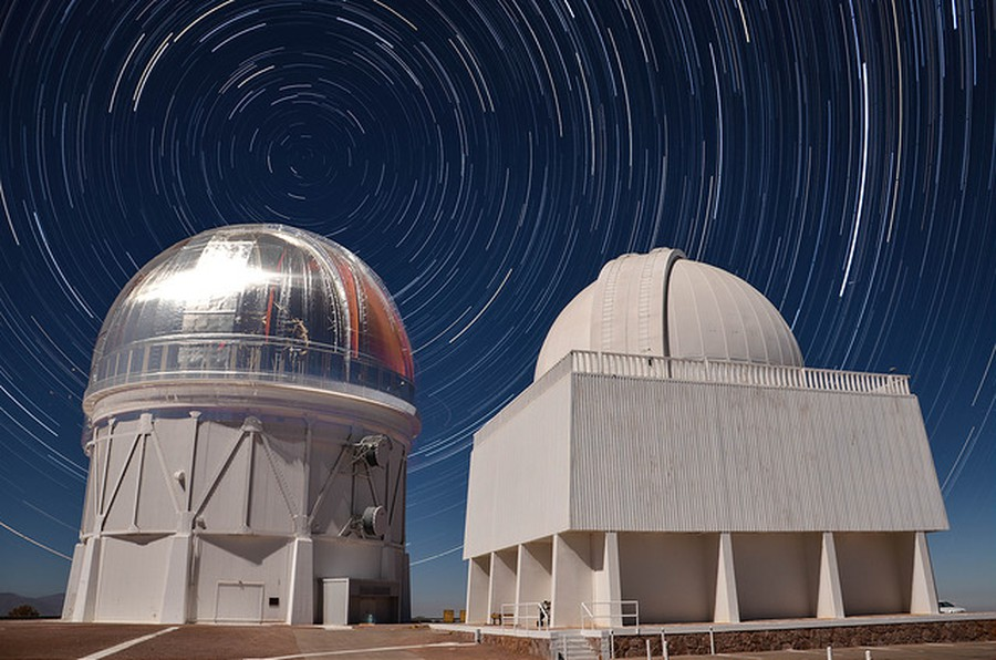 A star trail, or long-exposure photograph of the apparent motion of stars due to Earth's rotation, as captured by the Blanco Telescope in Chile.