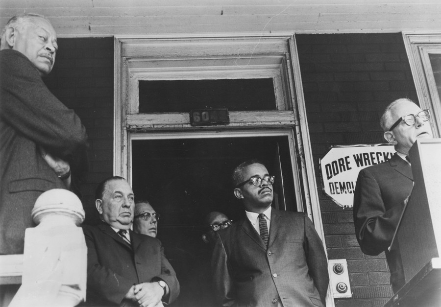 Claude Holman, alderman for the 4th Ward (far left), and Mayor Richard J. Daley (near left) listen to Julian Levi, the lead on the University's urban renewal efforts, at a news conference in 1966.