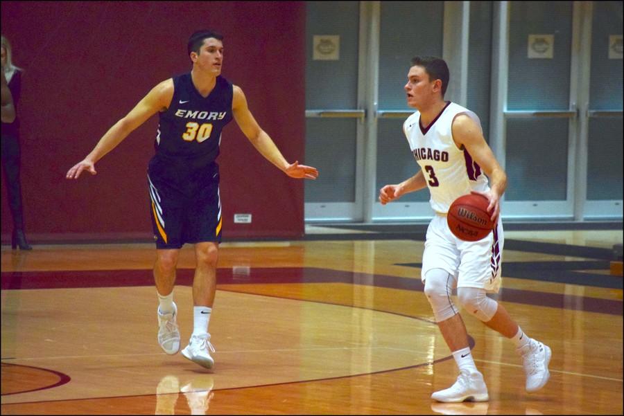Second-year Cole Schmitz handles the basketball.