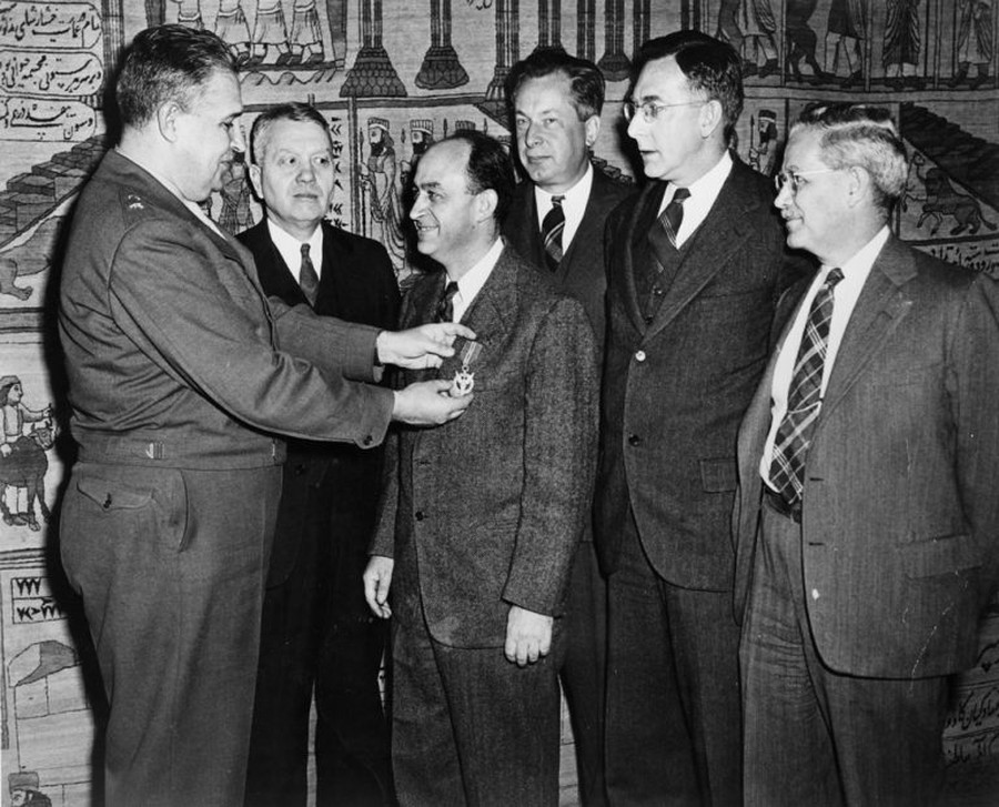 The director of the Manhattan District awards physicist Enrico Fermi and other University scientists Medals of Merit for their role in the successful development of the atomic bomb.