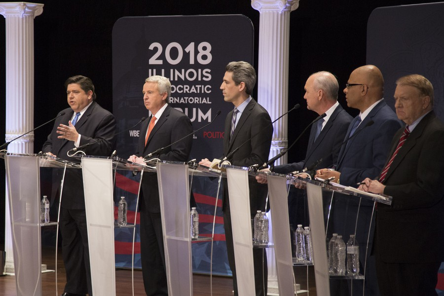 Democratic candidates for governor stand onstage during a gubernatorial forum at the Institute of Politics