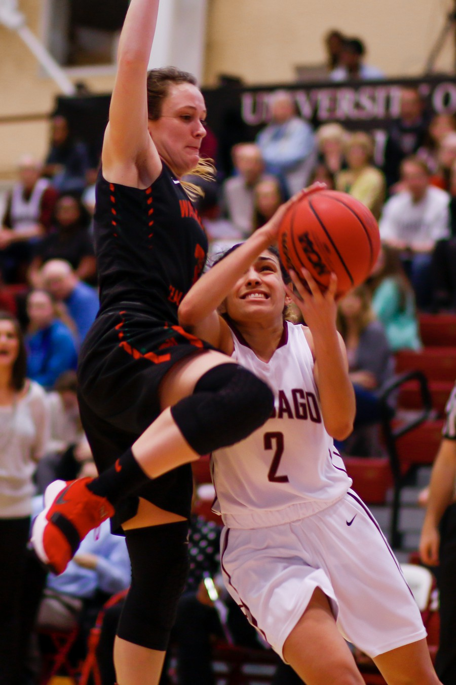 Second-year Mia Farrell gets physical as she goes up for a lay-up against Wash U.