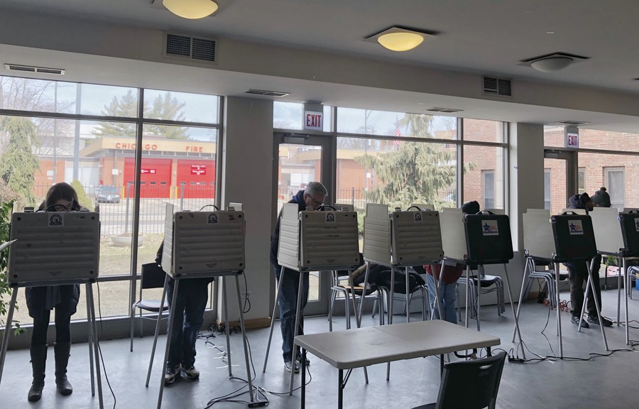 Voters fill out ballots at the Augustana Lutheran Church at 55th and University on March 20, 2018.