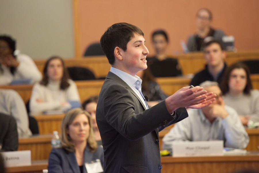 A student speaks at the College New Venture Challenge (CNVC)