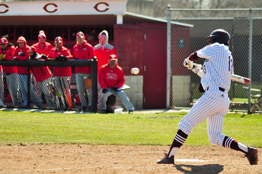 First-year James Kelly swings at a pitch.