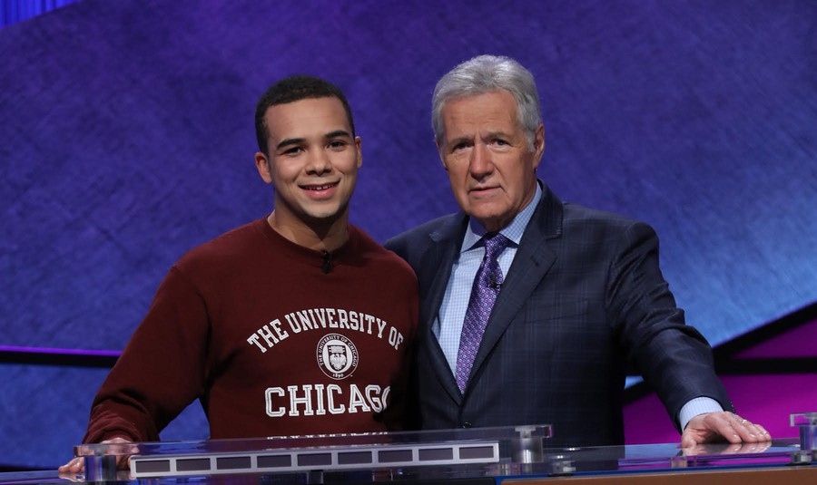 Fourth-year Harry Kioko poses on the Jeopardy! set with host Alex Trebek.