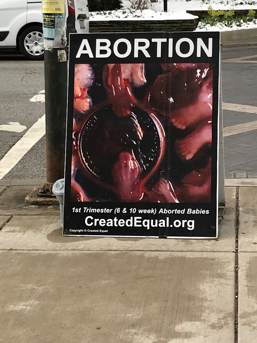 An anti-abortion poster displayed outside the Regenstein.