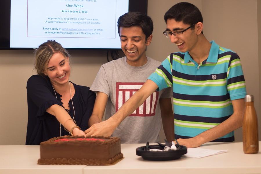 The winning Unite slate celebrates with cake.