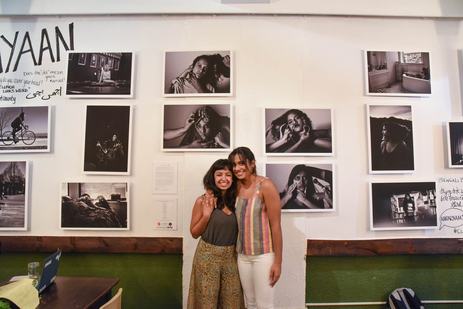 Fatima Khan and Shreya Sood pose next to their artwork.