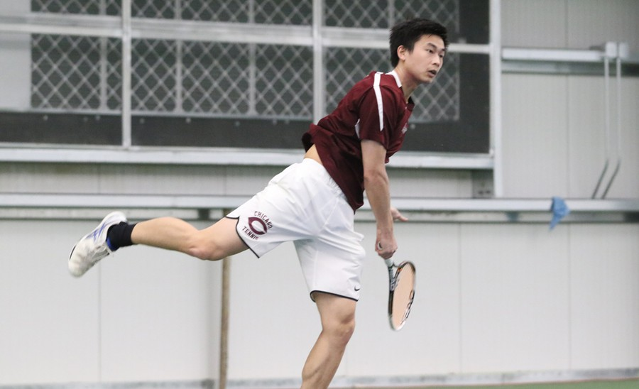 Fourth-year Luke Tsai powerfully hits a forehand towards his opponent.