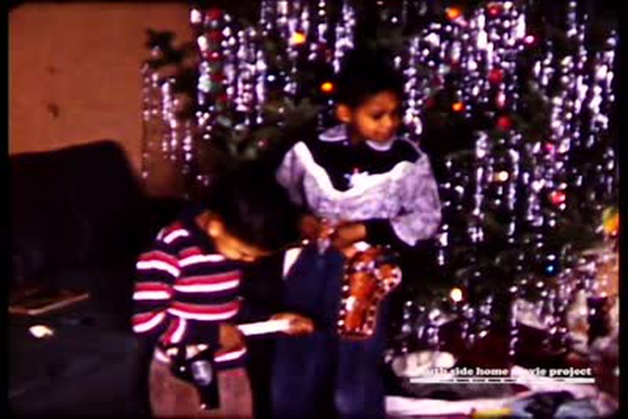 The Christmas season at the home of Dr. George Reed, a physicist at Argonne National Laboratories whose family lived on Calumet Avenue in Woodlawn. This still comes from a film shot in the 1950s.