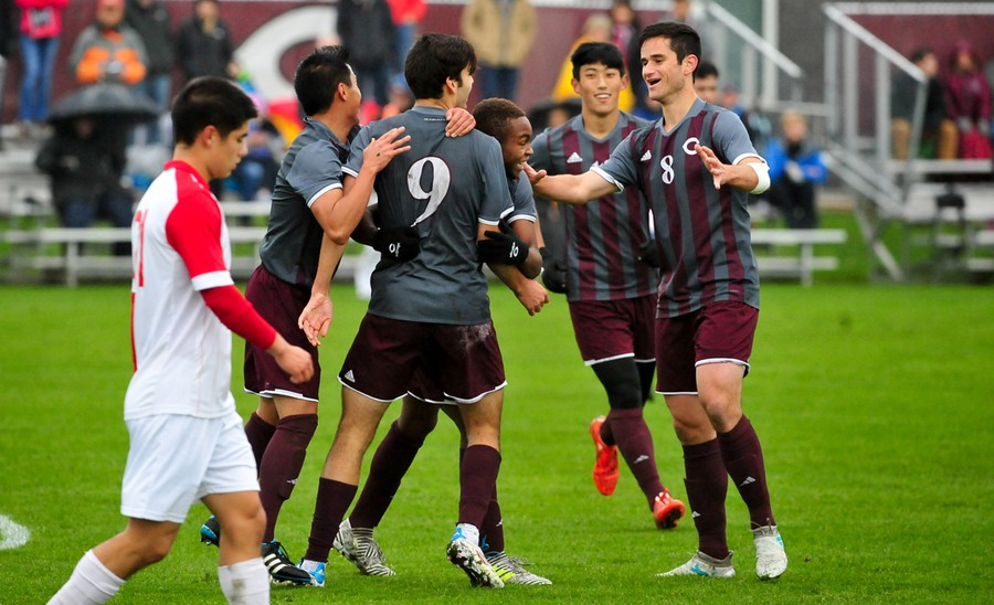 The men's soccer team celebrates the first goal of the game.
