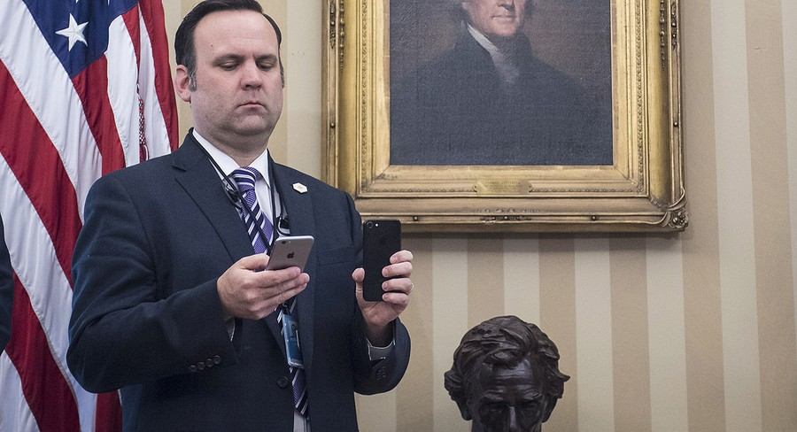 Dan Scavino, White House Director of Social Media and a co-defendant in Knight Institute v. Trump, films the President during a signing ceremony in the Oval Office.