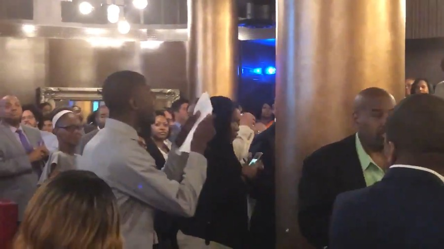 A protester interrupts the Aldermanic Black Caucus fundraiser before Cochran called him a gangster.